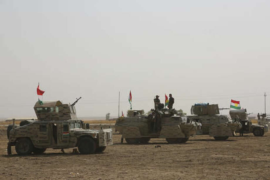 A peshmerga convoy drives towards a frontline in Khazer, about 30 kilometers (19 miles) east of Mosul, Iraq, Monday, Oct. 17, 2016. Iraqi government and Kurdish forces, backed by U.S.-led coalition air and ground support, launched coordinated military operations early on Monday as the long-awaited fight to wrest the northern city of Mosul from Islamic State fighters got underway.(AP Photo)