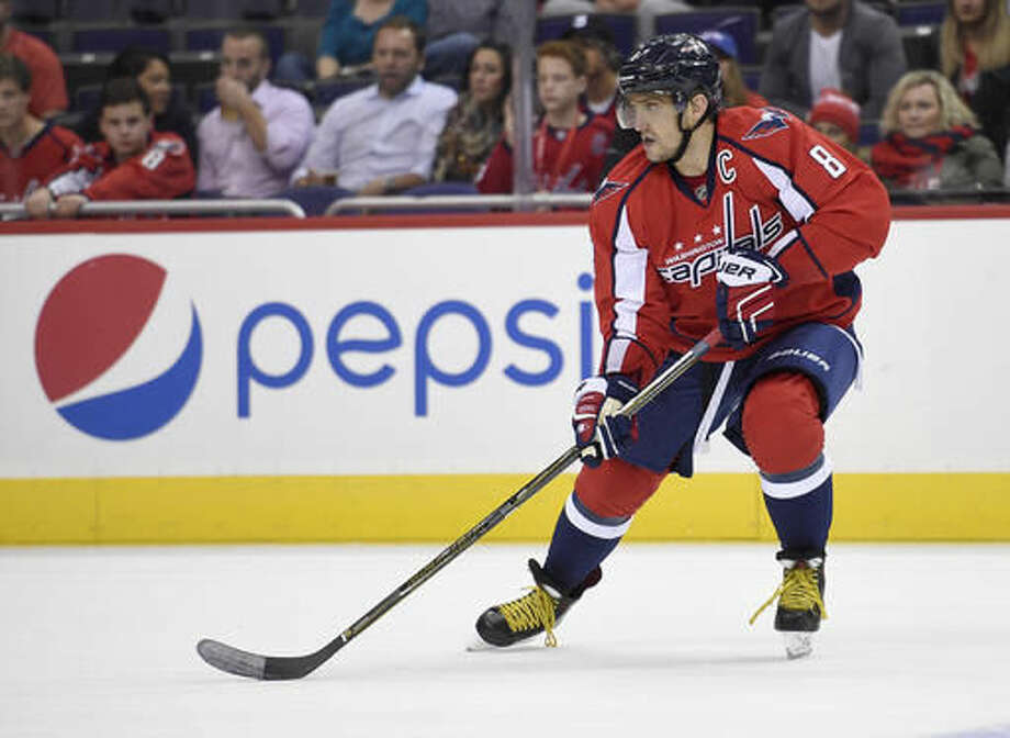 In this photo taken Oct. 3, 2016, Washington Capitals left wing Alex Ovechkin (8), of Russia, skates during overtime in an NHL preseason hockey game in Washington. Ovechkin and the Washington Capitals' power play is 0 for 8 through the first two games of the NHL season. Ovechkin has led the league in power-play goals the past four seasons while the Capitals have been a top-five unit. (AP Photo/Nick Wass)