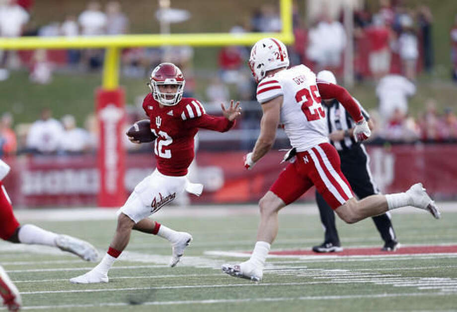 Indiana quarterback Zander Diamont tries to evade Nebraska safety Nathan Gerry (25) during the second half of an NCAA college football game in Bloomington, Ind., Saturday, Oct. 15, 2016. Nebraska won the game 27-22. (AP Photo/Sam Riche)