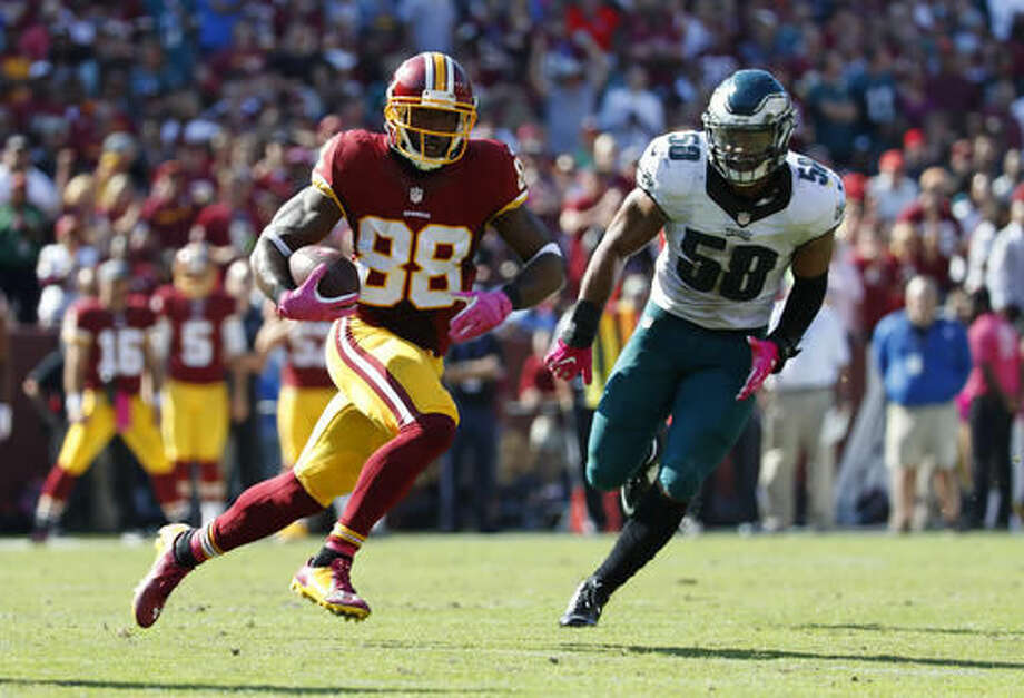 Washington Redskins wide receiver Pierre Garcon, left, rushes past Philadelphia Eagles middle linebacker Jordan Hicks in the first half of an NFL football game, Sunday, Oct. 16, 2016, in Landover, Md. (AP Photo/Alex Brandon)