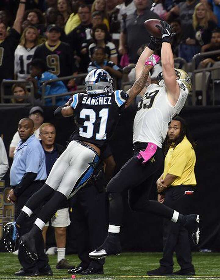 New Orleans Saints tight end Josh Hill (89) pulls in a touchdown reception over Carolina Panthers cornerback Zack Sanchez (31) in the second half of an NFL football game in New Orleans, Sunday, Oct. 16, 2016. (AP Photo/Bill Feig)