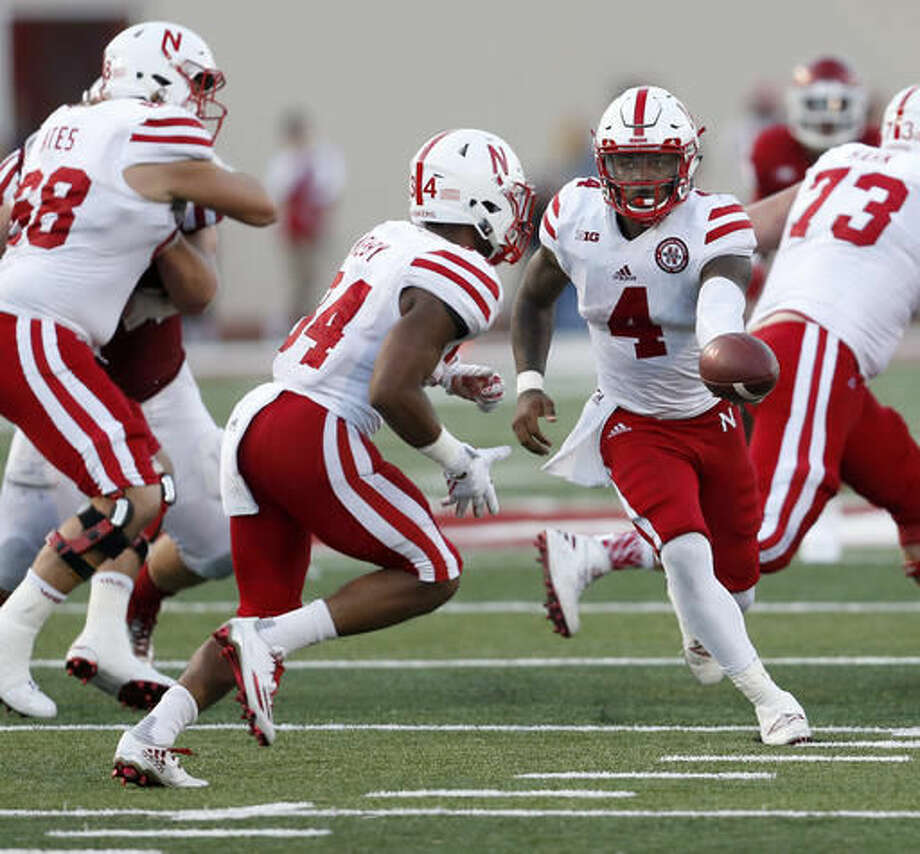 Nebraska quarterback Tommy Armstrong Jr. (4) hands off to running back Terrell Newby (34) against Indiana during the second half of an NCAA college football game in Bloomington, Ind., Saturday, Oct. 15, 2016. Nebraska won the game 27-22. (AP Photo/Sam Riche)