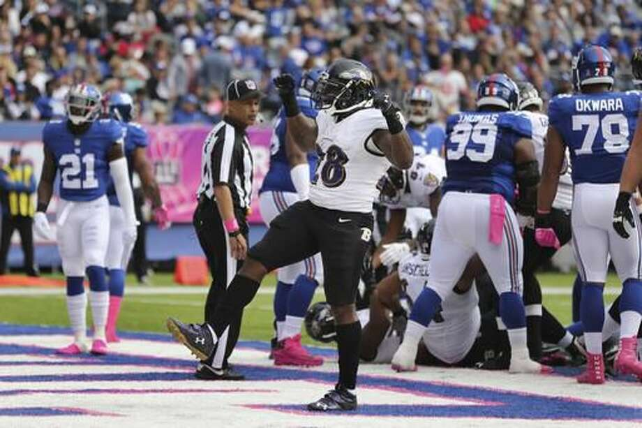 Baltimore Ravens running back Terrance West (28) celebrates after rushing for a touchdown during the first half of an NFL football game against the New York Giants, Sunday, Oct. 16, 2016, in East Rutherford, N.J. (AP Photo/Seth Wenig)