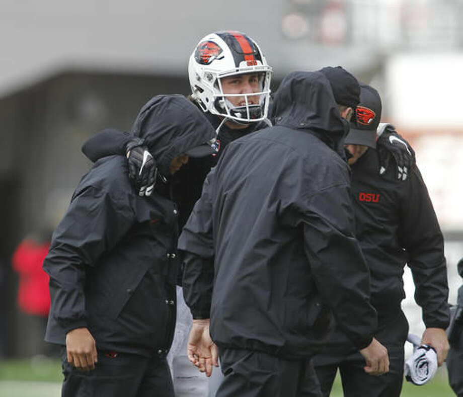 Oregon State starting quarterback Darell Garretson, center, is helped off the field after suffering an injury in the second half of an NCAA college football game against Utah, in Corvallis, Ore., on Saturday, Oct. 15, 2016. Utah won 19-14. (AP Photo/Timothy J. Gonzalez)
