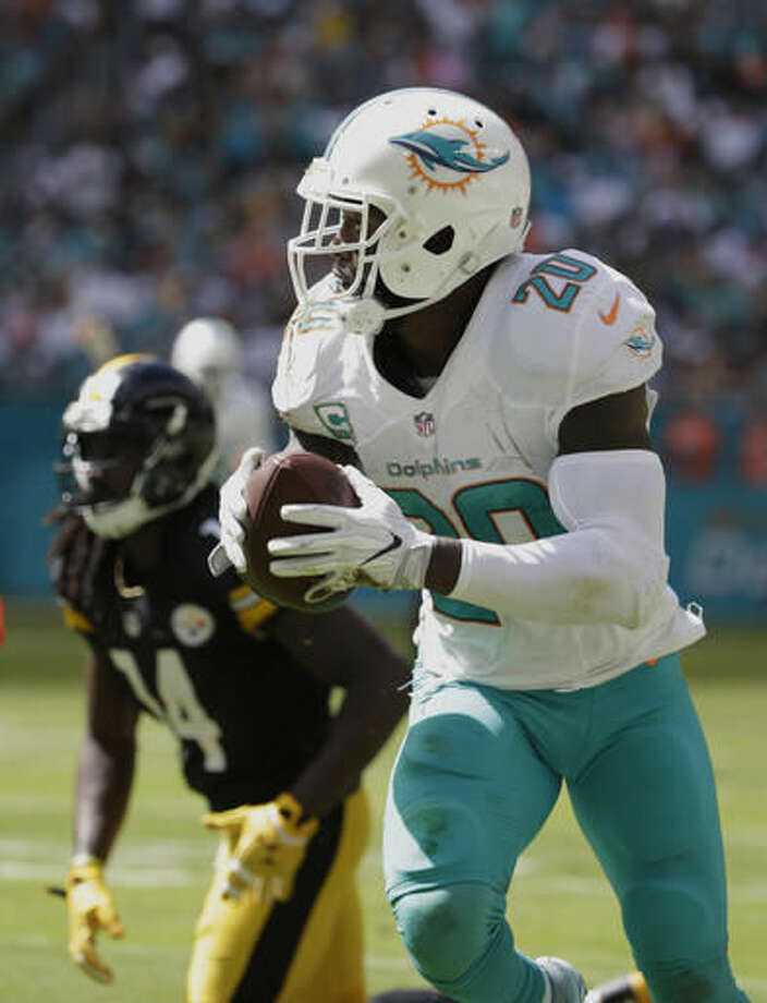 Miami Dolphins free safety Reshad Jones (20) intercepts a ball intended for Pittsburgh Steelers wide receiver Sammie Coates (14), during the first half of an NFL football game, Sunday, Oct. 16, 2016, in Miami Gardens, Fla. (AP Photo/Lynne Sladky)