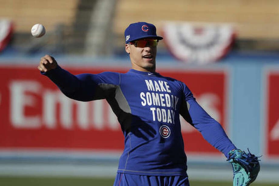 Chicago Cubs' Javier Baez warms up during practice ahead of Tuesday's Game 3 of the National League baseball championship series against the Los Angeles Dodgers, Monday, Oct. 17, 2016, in Los Angeles. (AP Photo/Jae C. Hong)