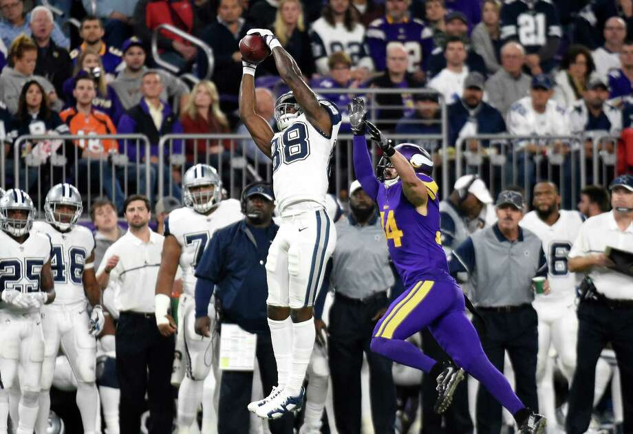 MINNEAPOLIS, MN - DECEMBER 1: Dez Bryant #88 of the Dallas Cowboys makes a leaping catch over Andrew Sendejo #34 of the Minnesota Vikings in the third quarter of the game on December 1, 2016 at US Bank Stadium in Minneapolis, Minnesota. (Photo by Hannah Foslien/Getty Images) Photo: Hannah Foslien, Stringer / 2016 Getty Images
