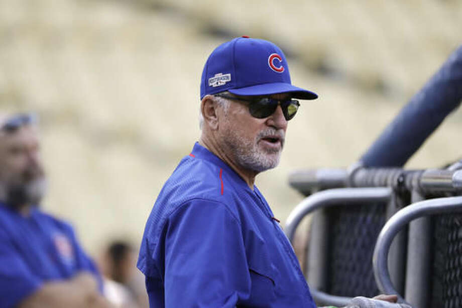 Chicago Cubs manager Joe Maddon watches his team's batting practice ahead of Tuesday's Game 3 of the National League baseball championship series against the Los Angeles Dodgers, Monday, Oct. 17, 2016, in Los Angeles. (AP Photo/Jae C. Hong)