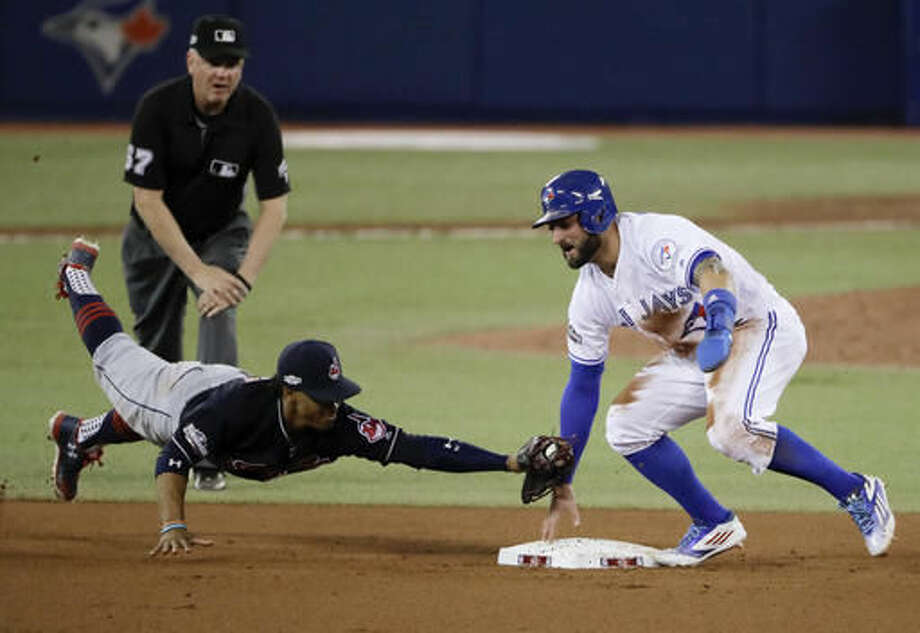 Toronto Blue Jays' Kevin Pillar, right, steals second past Cleveland Indians shortstop Francisco Lindor during the seventh inning in Game 3 of baseball's American League Championship Series in Toronto, Monday, Oct. 17, 2016. (AP Photo/Charlie Riedel)