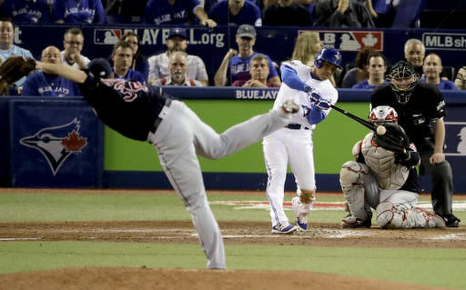 Toronto Blue Jays Ezequiel Carrera hits a triple off Cleveland Indians relief pitcher Zach McAllister during the fifth inning in Game 3 of baseball's American League Championship Series in Toronto, Monday, Oct. 17, 2016. (AP Photo/Charlie Riedel)