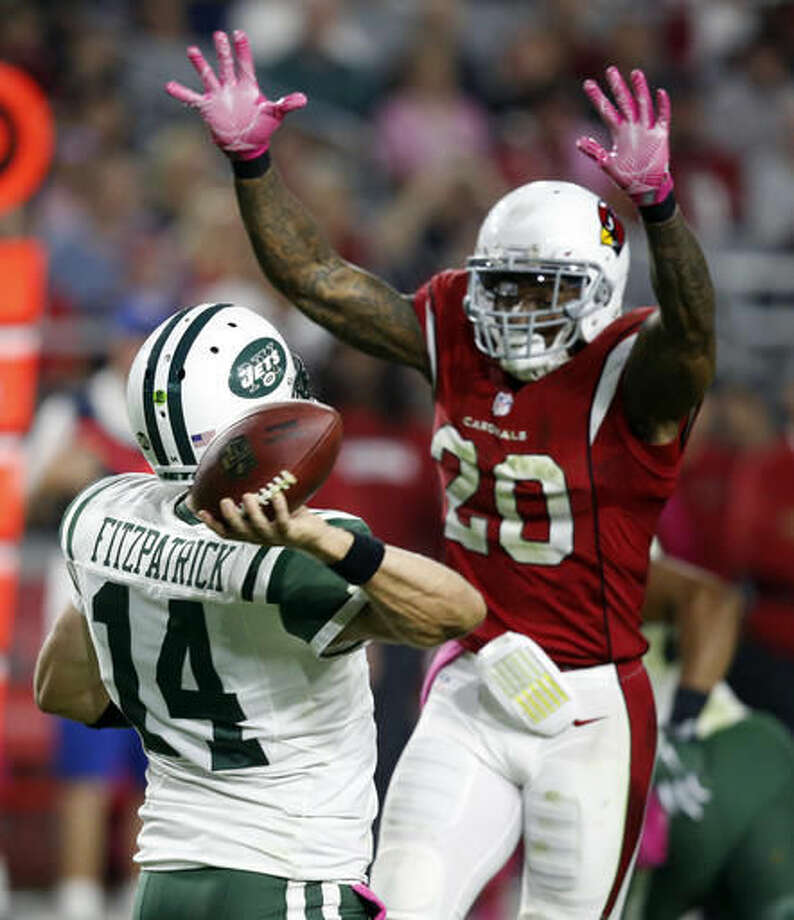 Arizona Cardinals outside linebacker Deone Bucannon (20) pressures New York Jets quarterback Ryan Fitzpatrick (14) during the first half of an NFL football game, Monday, Oct. 17, 2016, in Glendale, Ariz. (AP Photo/Ross D. Franklin)