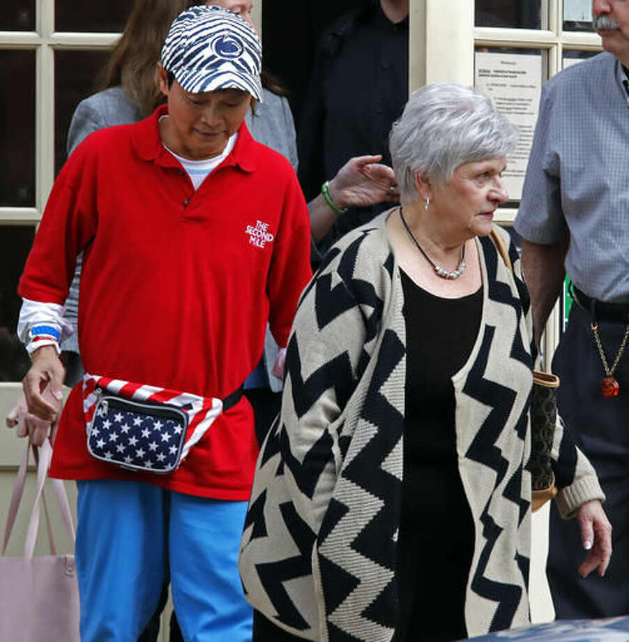 Dottie Sandusky, right, wife of jailed former Penn State University assistant football coach Jerry Sandusky, leaves the Centre County Courthouse Annex after attending the first day of trial for former Penn State assistant football coach Mike McQueary in Bellefonte, Pa., Monday, Oct. 17, 2016. A civil trial that's set to begin will determine if Penn State should pay for a claim it mistreated the former assistant coach who provided key evidence used to convict child molester Jerry Sandusky. (AP Photo/Gene J. Puskar)