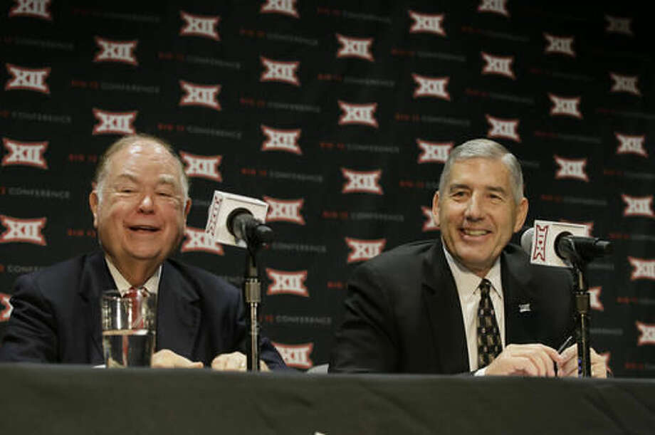 Oklahoma President David Boren, left, and Big 12 Commissioner Bob Bowlsby laugh during a news conference after The Big 12 Conference meeting in Grapevine, Texas, Monday, Oct. 17, 2016. The Big 12 Conference has decided against expansion from its current 10 schools after three months of analyzing, vetting and interviewing possible new members.(AP Photo/LM Otero)