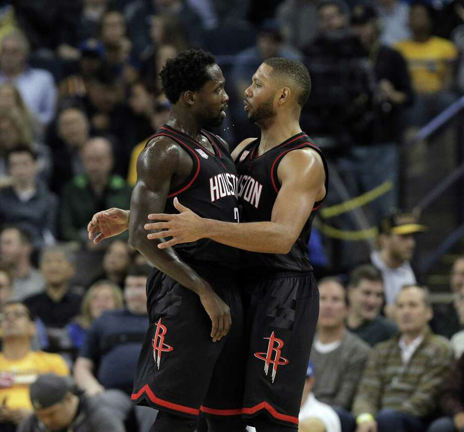 Patrick Beverley (2) and Eric Gordon (10) celebrate after a Rocket's score during the first half as the Golden State Warriors played the Houston Rockets at Oracle Arena in Oakland, Calif., on Thursday, December 1, 2016. Photo: Carlos Avila Gonzalez, The Chronicle / Carlos Avila Gonzalez - San Francisco Chronicle