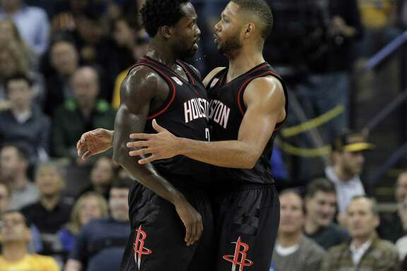 Patrick Beverley (2) and Eric Gordon (10) celebrate after a Rocket's score during the first half as the Golden State Warriors played the Houston Rockets at Oracle Arena in Oakland, Calif., on Thursday, December 1, 2016.