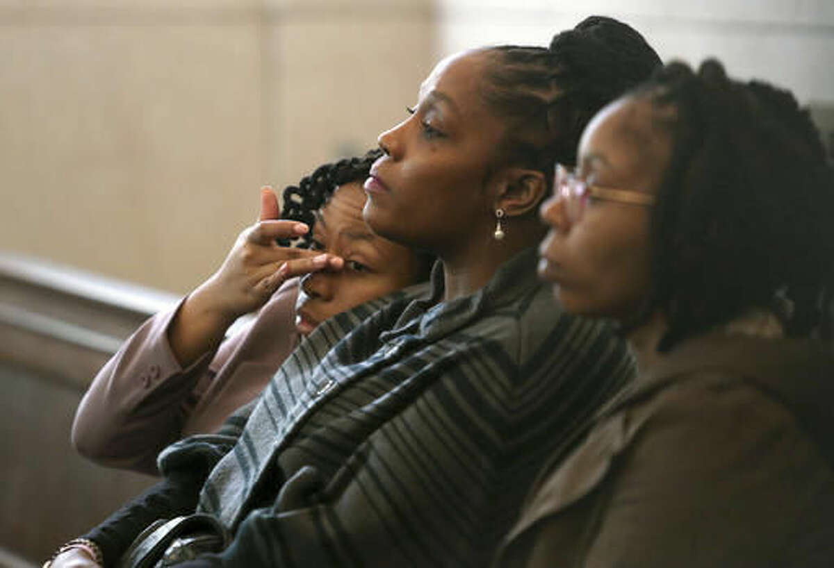DaShonda Reid, center, Sam DuBose's longtime fiancée, waits for Ray Tensing's pre-trial hearing to begin Friday, Oct. 14, 2016, in Cincinnati. The former University of Cincinnati police officer is charged with killing DuBose, an unarmed black man during a traffic stop over a missing front license plate. (Amanda Rossmann/The Philadelphia Inquirer via AP, Pool)