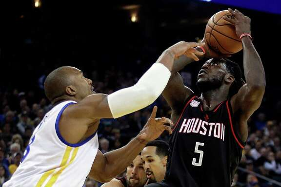 Houston Rockets' Montrezl Harrell, right, shoots against Golden State Warriors' David West during the first half of an NBA basketball game Thursday, Dec. 1, 2016, in Oakland, Calif. (AP Photo/Ben Margot)