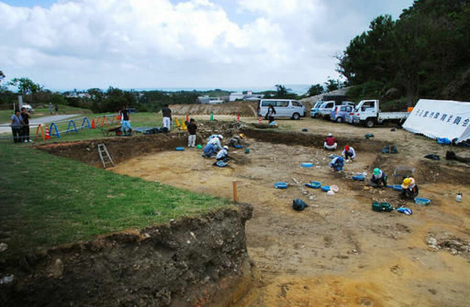 In this 2013 photo released by Uruma City Board of Education, people work at an excavation site where 10 coins including a few likely dating to the Roman Empire were found at Katsuren Castle in Uruma on Japan's southernmost prefectural island of Okinawa. The 10 copper coins were unearthed in December 2013 at the 12th-15th century Katsuren Castle, a UNESCO World Heritage site, during an annual excavation for study and tourism promotion by the board of education in Uruma, a city in central Okinawa. While the find has yet to be submitted for publication in an academic journal, an outside expert is convinced that the coins are real. (Uruma City Board of Education via AP)