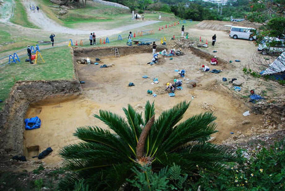 This 2013 photo released by Uruma City Board of Education shows an excavation site where 10 coins including a few likely dating to the Roman Empire were found at Katsuren Castle in Uruma on Japan's southernmost prefectural island of Okinawa. The 10 copper coins were unearthed in December 2013 at the 12th-15th century Katsuren Castle, a UNESCO World Heritage site, during an annual excavation for study and tourism promotion by the board of education in Uruma, a city in central Okinawa. While the find has yet to be submitted for publication in an academic journal, an outside expert is convinced that the coins are real. (Uruma City Board of Education via AP)