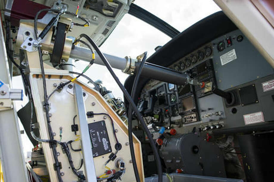 Aurora Flight Sciences' Aircrew Labor In-Cockpit Automantion System (ALIAS), is mounted in the co-pilot seat of a Cessena Caravan aircraft at Manassas Airport in Manassas, Va., Monday, Oct. 17, 2016. Government and industry are working together on a robot-like autopilot system that could eliminate the need for a second human pilot in the cockpit. (AP Photo/Cliff Owen)