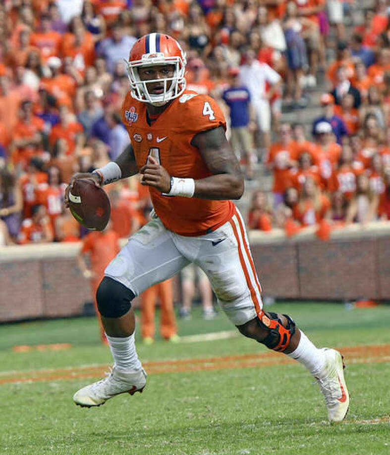 FILE - In this Oct. 15, 2016, file photo, Clemson quarterback Deshaun Watson scrambles out of the pocket against North Carolina State during the second half of an NCAA college football game, in Clemson, S.C. Watson threw for a season-high 378 yards and the winning touchdown in overtime against North Carolina State. (AP Photo/Richard Shiro, File)