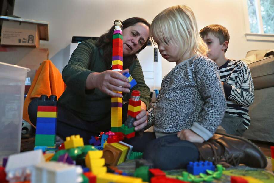 Toni Gardner plays with her grandchildren, Amelia, 2, and Jonah, 5, in the second unit that she had built in the backyard of her residence. The new laws would have removed some of the obstacles, she said. Photo: Scott Strazzante, The Chronicle