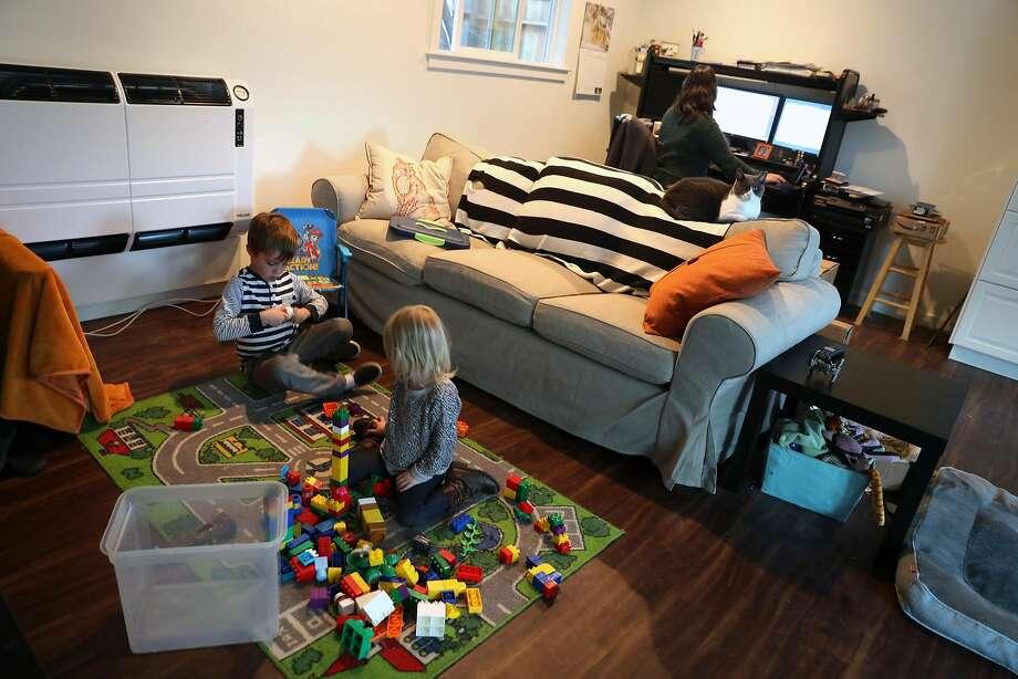 Toni Gardner's grandchildren, Jonah, 5, and Amelia, 2, play in the small house that Gardner had built in the backyard of her residence near Santa Cruz. Photo: Scott Strazzante, The Chronicle