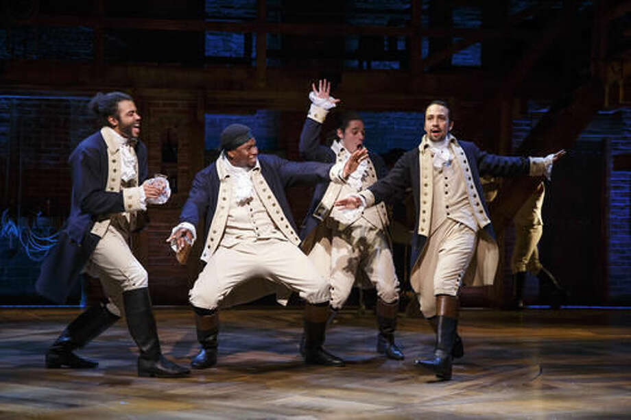 "In this image released by PBS, from left, Daveed Diggs, Okieriete Onaodowan, Anthony Ramos and Lin-Manuel Miranda perform in the musical, ""Hamilton."" The documentary ""Hamilton's America"" debuts on PBS on Friday as part of its Great Performances series, offering a behind-the-scenes look at the musical's creation and putting it in historical context. (Joan Marcus/PBS via AP)"