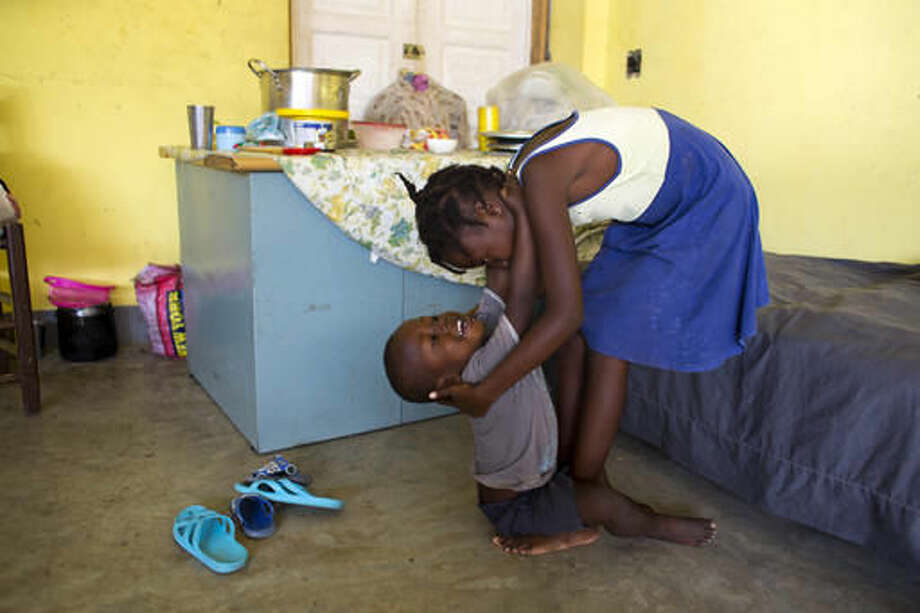 Love Manie Simeus, 12, plays with her 4-year-old brother Jean Etienne inside what was once her school, now a shelter for residents who lost their homes to Hurricane Matthew in the village of Mersan, located in Camp-Perrin, a district of Les Cayes, Haiti, Oct. 16, 2016. While Love is doing her best to keep busy, she is having nightmares about Matthew's shrieking winds. (AP Photo/Dieu Nalio Chery)
