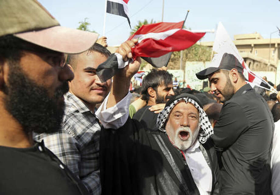 Supporters of Shiite cleric Muqtada al-Sadr demonstrate in front of the Turkish Embassy calling for the immediate withdrawal of Turkish troops from northern Iraq, in Baghdad, Iraq, Tuesday, Oct. 18, 2016. Thousands of followers of al-Sadr are demanding the withdrawal of Turkish troops from a base near the northern city of Mosul. Turkey says the troops are training Iraqi fighters to help retake Mosul from the Islamic State group, and that they are there with the permission of the Iraqi government. Baghdad denies it granted permission and has ordered them to withdraw -- a call Ankara has ignored. (AP Photo/Karim Kadim)