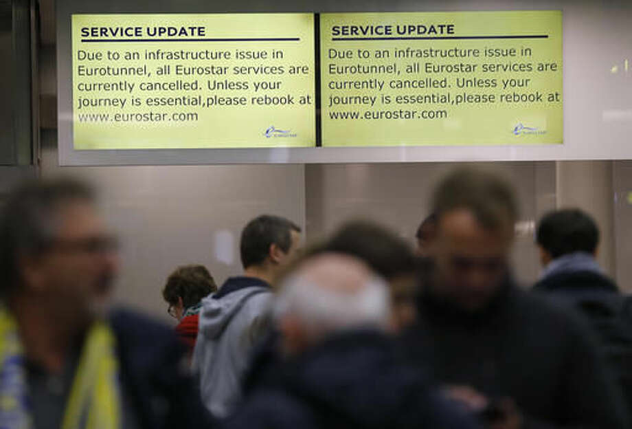 A service update is posted on a screen as travelers wait at St Pancras International train station in London, as Eurotunnel trains were suspended on Tuesday, Oct. 18, 2016. An electrical supply problem in the train tunnel beneath the English Channel has blocked Eurostar traffic between Britain and the European continent. (AP Photo/Frank Augstein)