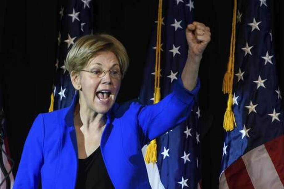 In this photo taken Oct. 14, 2016, Sen. Elizabeth Warren, D-Mass. speaks at a rally for Missouri Democratic Senate candidate, Secretary of State Jason Kander, in Kansas City, Mo. From liberal California to conservative Missouri, there are few places Warren won't go this election season. The Massachusetts Democrat is campaigning for Hillary Clinton, for Senate candidates and for progressive policies, banking political capital that she could end up spending in ways Clinton and other Democratic leaders won't like. (AP Photo/Reed Hoffmann)