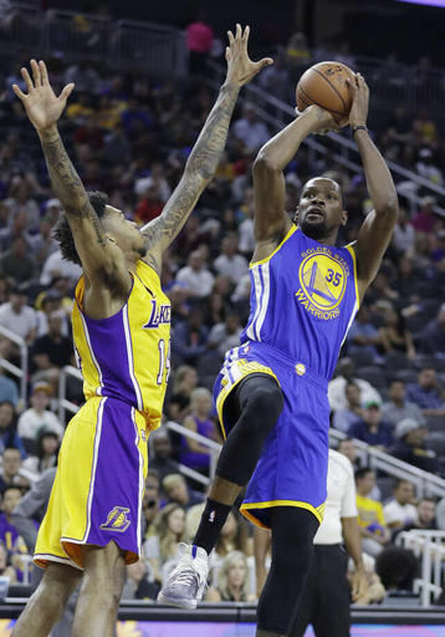 Golden State Warriors' Kevin Durant shoots over Los Angeles Lakers' Brandon Ingram during the first half of an NBA preseason basketball game Saturday, Oct. 15, 2016, in Las Vegas. (AP Photo/John Locher)