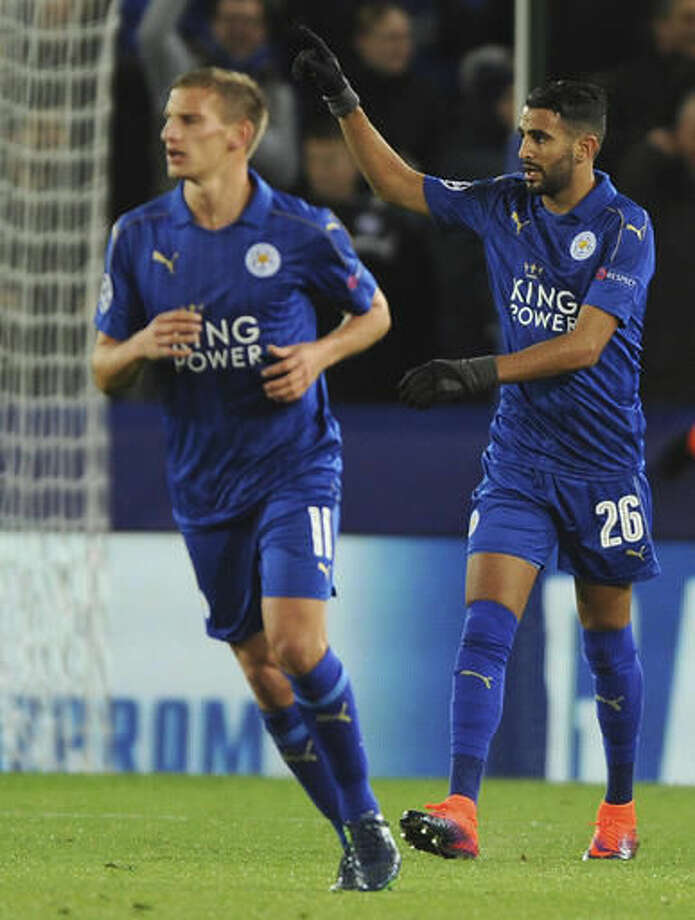 Leicester's Riyad Mahrez, right, celebrates scoring a goal during the Champions League Group G soccer match between Leicester City and FC Copenhagen at the King Power stadium in Leicester, England, Tuesday, Oct. 18, 2016. (AP Photo/Rui Vieira)