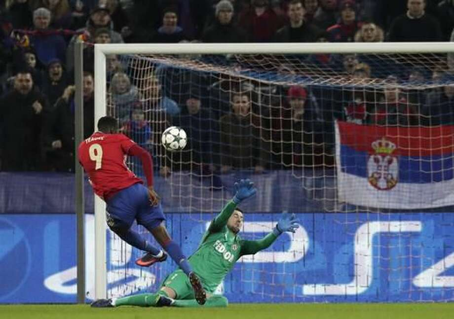 CSKA's Lacina Traore, back to a camera, tries to score against Monaco's goalkeeper Danijel Subasic during the Champions League Group E soccer match between CSKA Moscow and Monaco in Moscow, Russia, Tuesday, Oct. 18, 2016. (AP Photo/Pavel Golovkin)