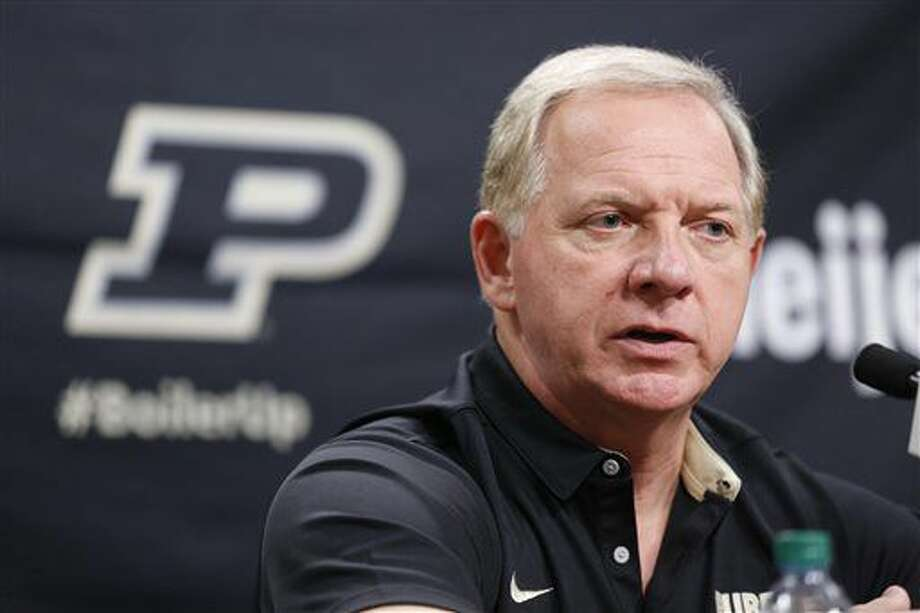 Purdue athletic director Mike Bobinski announces that Darrell Hazell has been fired as head football coach Sunday, Oct. 16, 2016, at Purdue University in West Lafayette, Ind. Gerad Parker was named as interim head coach. (John Terhune/Journal & Courier via AP)