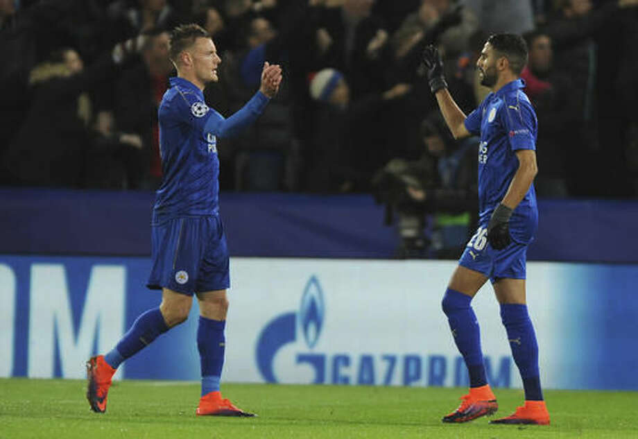 Leicester's Riyad Mahrez, right, celebrates with Leicester's Jamie Vardy after scoring a goal during the Champions League Group G soccer match between Leicester City and FC Copenhagen at the King Power stadium in Leicester, England, Tuesday, Oct. 18, 2016. (AP Photo/Rui Vieira)