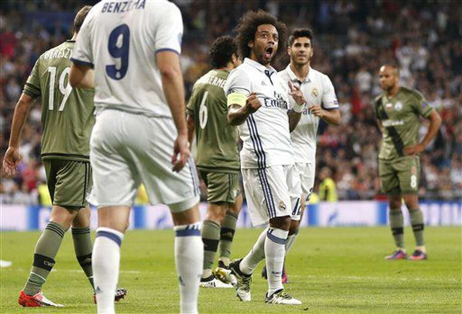 Real Madrid's Marcelo celebrates scoring his side's 2nd goal during a Champions League, Group F soccer match between Real Madrid and Legia Warsaw, at the Santiago Bernabeu stadium in Madrid, Tuesday, Oct. 18, 2016. (AP Photo/Daniel Ochoa de Olza)