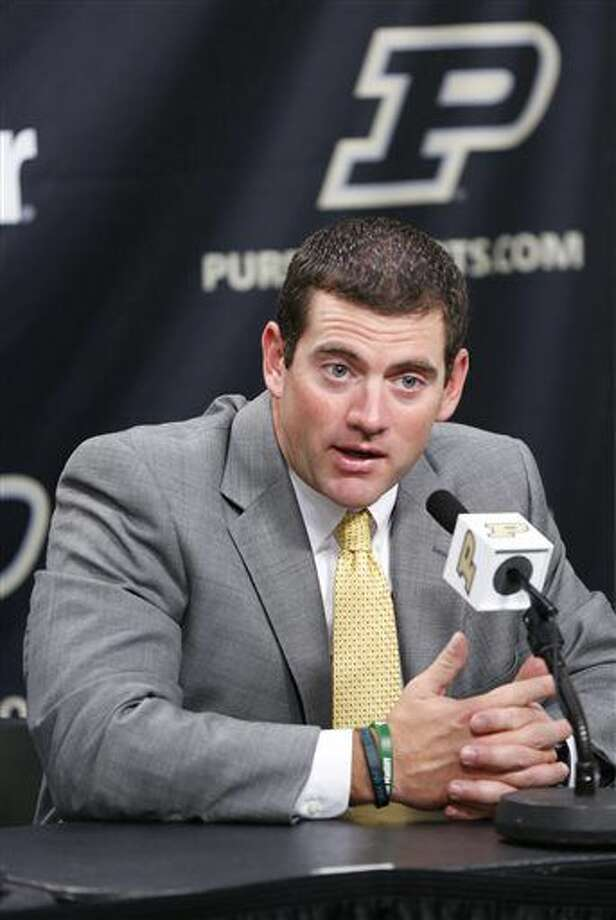 Interim head coach Gerad Parker addresses the media following the announcement that Darrell Hazell had been fired as head football coach Sunday, Oct. 16, 2016, at Purdue University in West Lafayette, Ind. (John Terhune/Journal & Courier via AP)