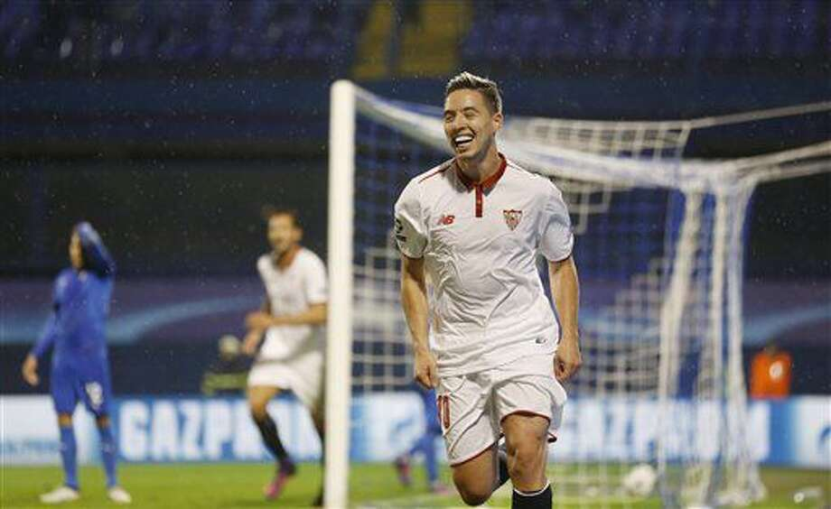 Sevilla's Samir Nasri celebrates after scoring during the Champions League Group H soccer match between Dinamo Zagreb and Sevilla, at the Maksimir stadium in Zagreb, Croatia, Tuesday, Oct. 18, 2016. (AP Photo/Darko Bandic)
