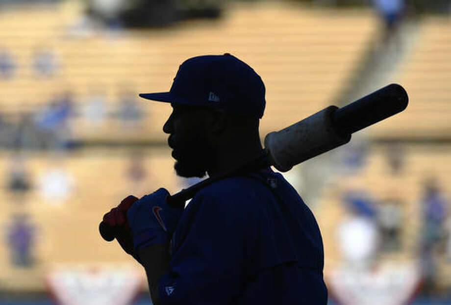 Chicago Cubs' Jason Heyward gets ready to bat before Game 3 of the National League baseball championship series against the Los Angeles Dodgers Tuesday, Oct. 18, 2016, in Los Angeles. (AP Photo/Mark J. Terrill)
