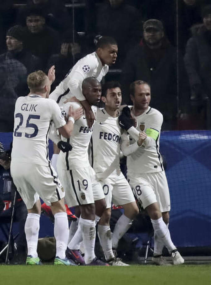Monaco's team players celebrate their score against CSKA Moscow during the Champions League Group E soccer match between CSKA Moscow and Monaco in Moscow, Russia, Tuesday, Oct. 18, 2016. (AP Photo/Pavel Golovkin)