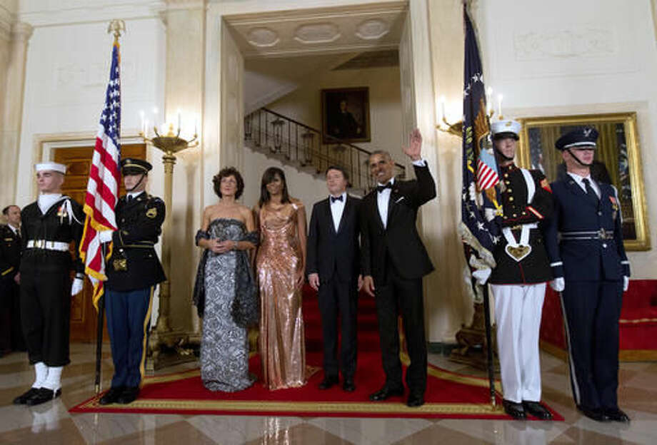 President Barack Obama, right, and first lady Michelle Obama, second from left, stand with Italian Prime Minister Matteo Renzi, second from right, and his wife Agnese Landini, left, for an official photograph at the White House in Washington, Tuesday, Oct. 18, 2016, before they attend a state dinner. (AP Photo/Carolyn Kaster)