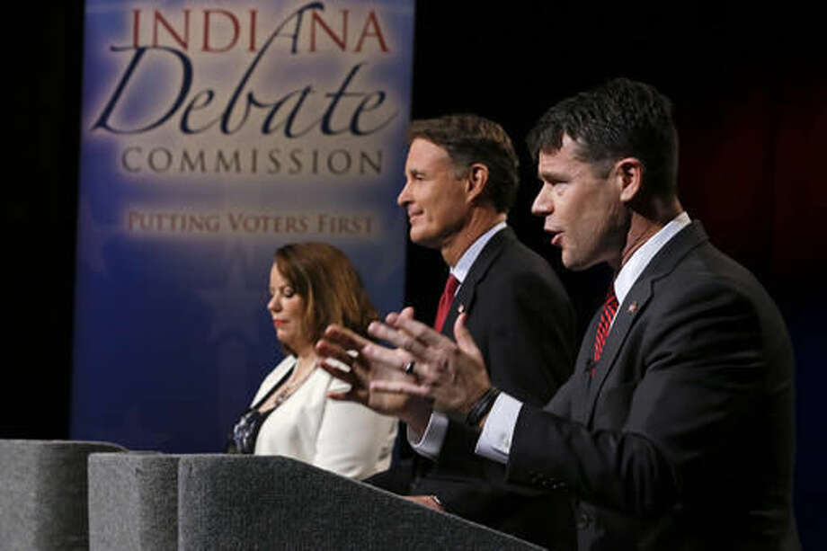 The three candidates for Indiana's open U.S. Senate seat, from left, Libertarian Lucy Brenton, Democrat Evan Bayh and Republican Todd Young participate in debate in Indianapolis, Tuesday, Oct. 18, 2016. The Indiana campaign has become a key national race as Democrats try to capture the seat now held by retiring Republican Sen. Dan Coats and overturn the GOP's narrow Senate majority. (AP Photo/Michael Conroy, Pool)