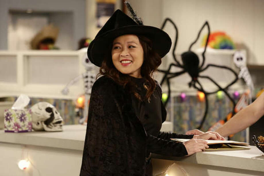 "In this image released by ABC, Suzy Nakamura appears in a scene from the upcoming Halloween episode of ""Dr. Ken,"" airing Oct. 21, on ABC. (Nicole Wilder/ABC via AP)"