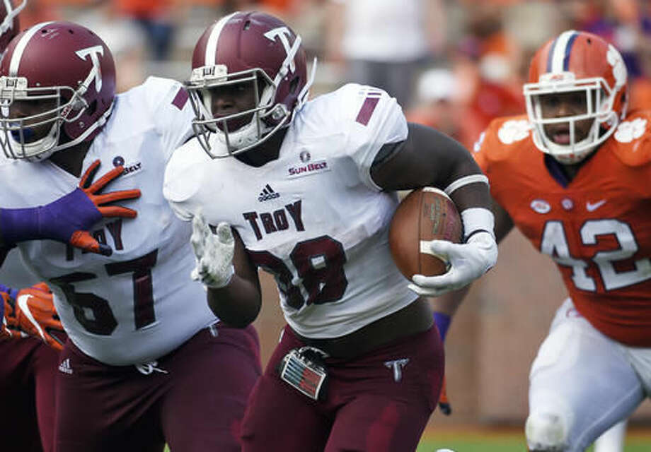 FILE - In this Sept. 10, 2016, file photo, Troy running back Jordan Chunn (38) rushes against Clemson during the second half an NCAA college football game in Clemson, S.C. The Troy Trojans have staged a major comeback. A program that hasn't had a winning record since 2010 is on the brink of bowl eligibility, lead the Sun Belt Conference and flirted with an upset of No. 4 Clemson. (AP Photo/Rainier Ehrhardt, File)