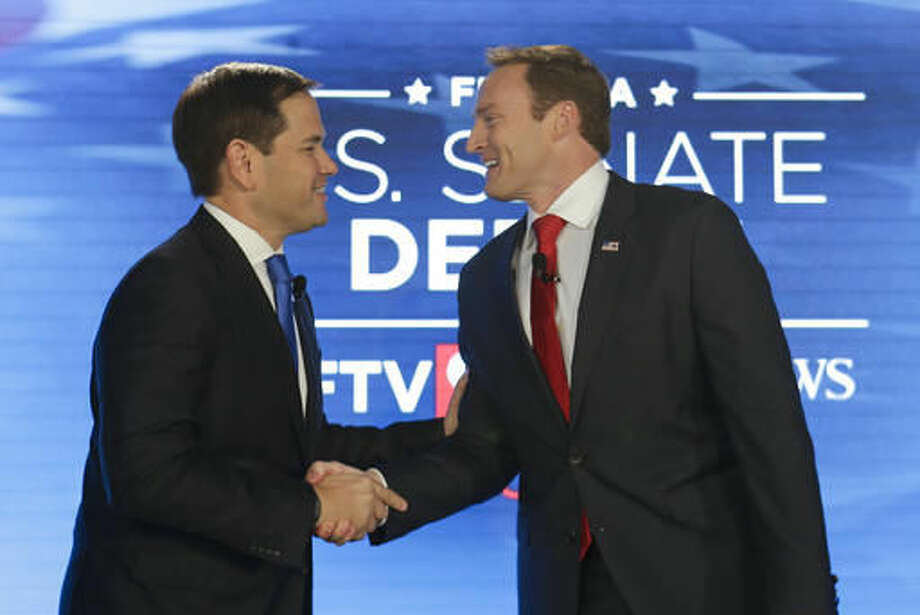 Sen. Marco Rubio, R-Fla., left, and Rep. Patrick Murphy, D-Fla., shake hands before their debate at the University of Central Florida, Monday, Oct. 17, 2016, in Orlando, Fla. (AP Photo/John Raoux)