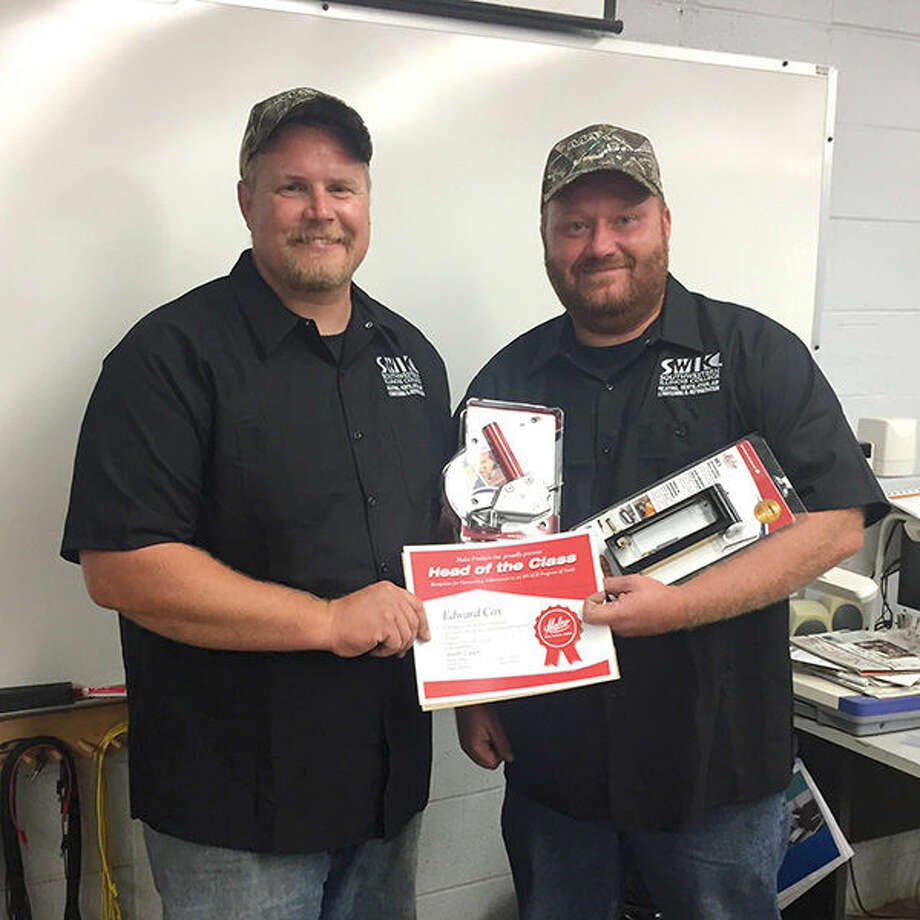 Southwestern Illinois College Heating, Ventilation, Air Conditioning and Refrigeration Program Coordinator Keith Otten, left, presents SWIC HVAR graduate Ed Cox with the Head of Class Award, recognizing his commitment to his field. Cox works for Viviano Heating and Cooling in Collinsville.