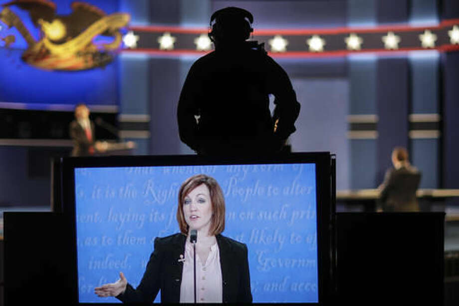 A student standing in for Democratic presidential nominee Hillary Clinton is captured on the large monitor during a rehearsal for the third presidential debate at UNLV in Las Vegas, Tuesday, Oct. 18, 2016. (AP Photo/David Goldman)
