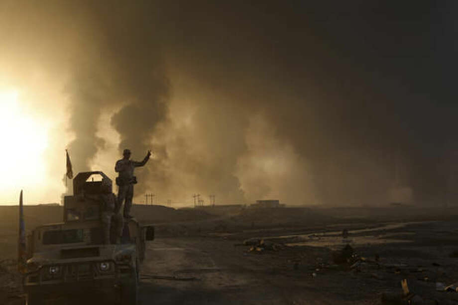 Smoke rises from Islamic state positions after an airstrike by coalition forces in Mosul, Iraq, Tuesday, Oct. 18, 2016. The pace of operations slowed on Tuesday as Iraqi forces began pushing toward larger villages and encountering civilian populations on the second day of a massive operation to retake the northern Iraqi city of Mosul from the Islamic State group. (AP Photo)